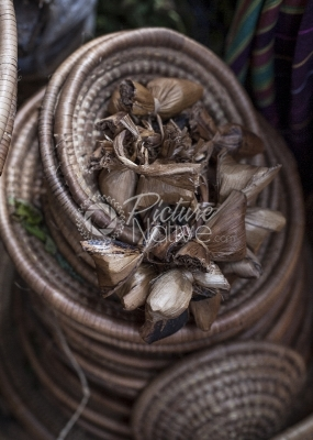 Coffee seeds tied in Banana fibre and placed in baskets.