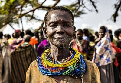 A Karamojong elderly woman with beads around her neck