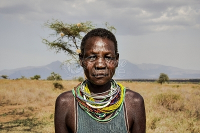 A Karamojong woman with beads around her neck
