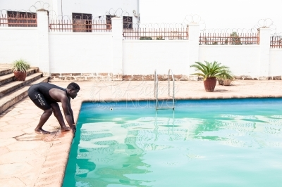 A man getting ready to dive into the swimming pool