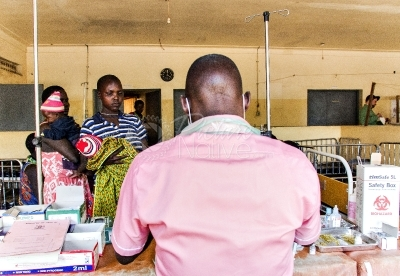A medical worker attending to teenage mothers