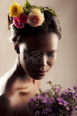 A model dressed up in natural flowers