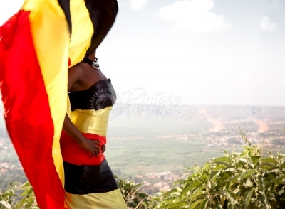 A woman dressed in Uganda national colors