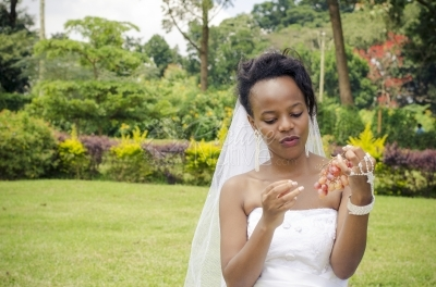 A young bride holding grapes