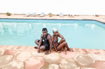 A young couple at the swimming pool