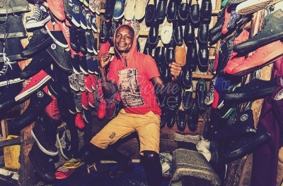 A young man inside his shoe kiosk