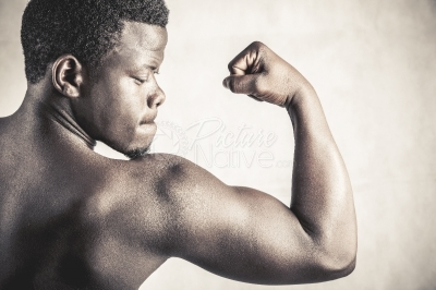 A young man showing off his biceps