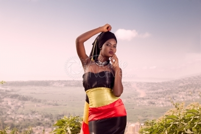 A young woman dressed in Uganda national colors
