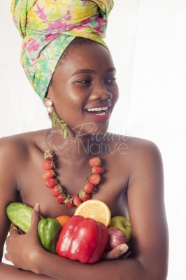 A young woman holding fruits