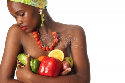 A young woman holding fruits and vegetables