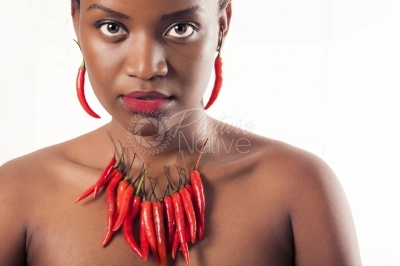 A young woman putting on red pepper accessories