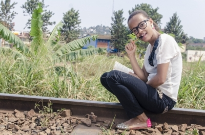 A young woman relaxing from a rail line