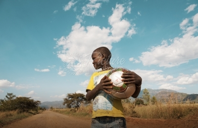 African boy holding a football