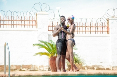 An intimate couple at swimming pool