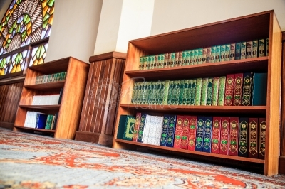 Book shelf containing Koran and other books