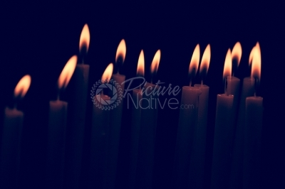 Candles burning over a dark background