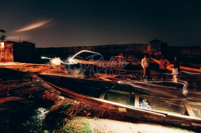 Canoes at a shore of a lake at night