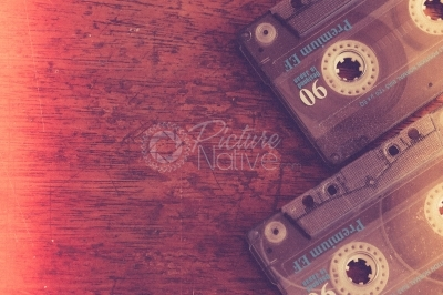 Cassette tapes on a wooden background