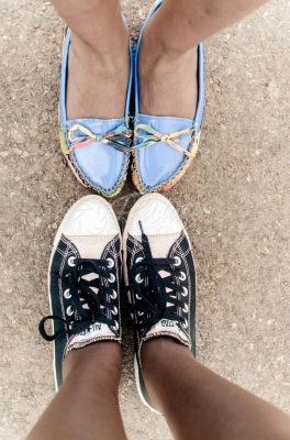 Closeup of the shoes of two friends