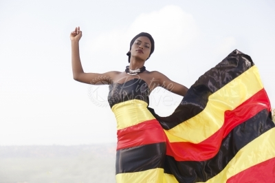Fashion model in Uganda flag inspired dress
