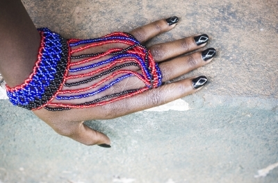 Female hand wearing cultural beads