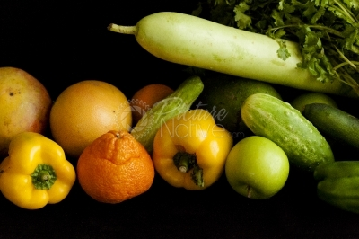 Fruits and vegetables on a dark barkground