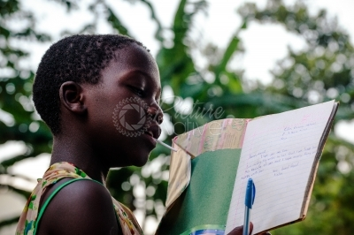 Girl reading a letter in her book