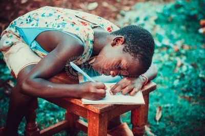 Girl writing in a book