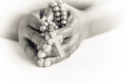 Hands holding a rosary