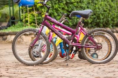Kids bikes parked outdoors