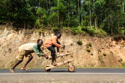 Kids ridding a wooden bike