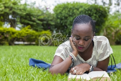 Lady reading a novel from a park