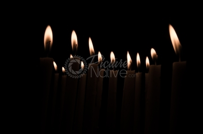 Lighting candles over a dark background
