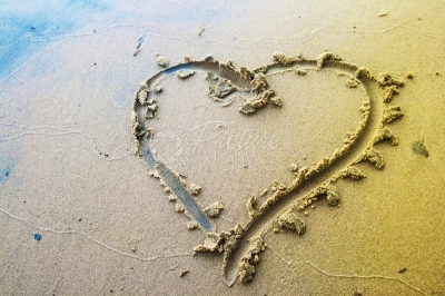 Love symbol drawn in sand
