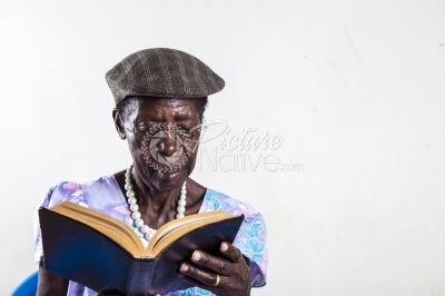 Old lady reading the bible