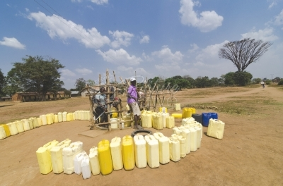 People fetching water in an arid area