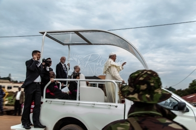Pope Francis waves to a crowd during Uganda Visit