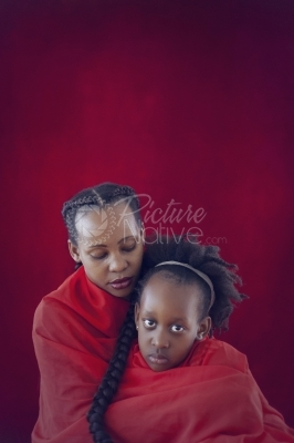 Portrait of a woman and girl in red