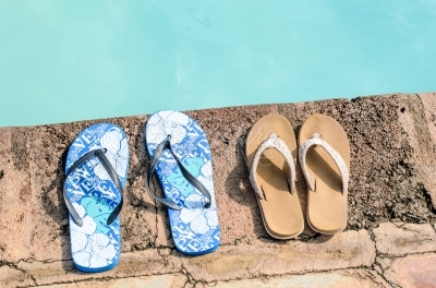 Sandals besides the swimming pool