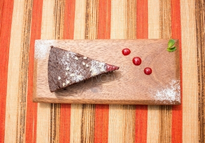 Slice of cake on a board