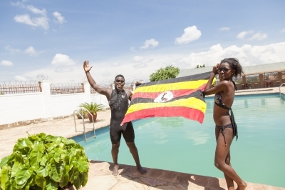 Swimmers with a Uganda flag