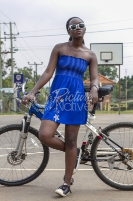Trendy girl with a bicycle