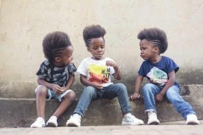 Triplet boys playing