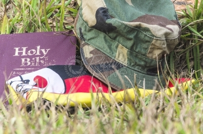 Uganda flag, bible and army cap