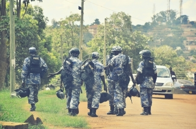Uganda police officers wearing anti riot gear