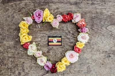 Ugandan flag on a heart-shaped floral background