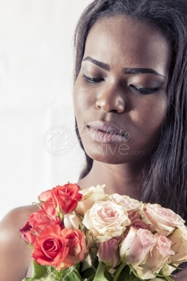 Unhappy woman with a bouquet of flowers