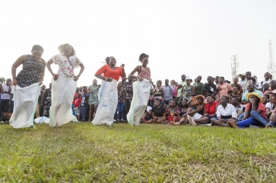 Women compete in sack racing at a cultural gala