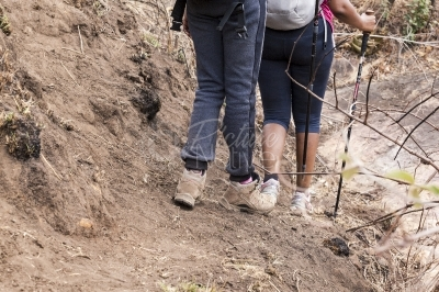 Women walking in a rough terrain