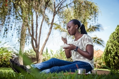 Young lady taking tea outdoors